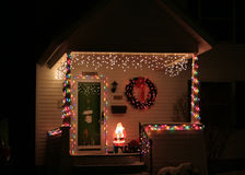 Xmas house. Old fashion house list up with Christmas lights at night Royalty Free Stock Photos