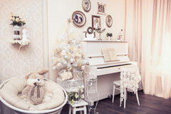 Xmas Interior Design Includes White Decorated Christmas Tree With Hand Made Ornaments, Gift Boxes Under It And White Piano. Winter Royalty Free Stock Image