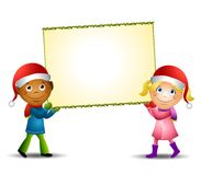 Xmas Kids Carrying Sign Royalty Free Stock Photography
