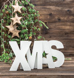 XMAS letter and christmas ornaments over wooden background Stock Images