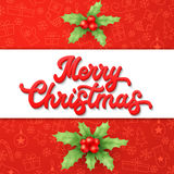 Xmas lettering and holly on red Christmas backdrop Stock Photo