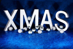 Xmas letters with decorations on background Royalty Free Stock Images
