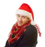 Xmas man 5. A man dressed in suit, xmas hat and tinsel; over white background stock images