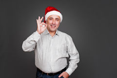 Xmas man showing ok sign Stock Images