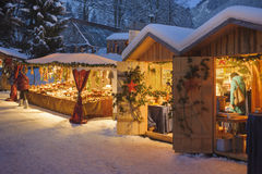 Xmas market in Bavaria, germany, in snow at night. Christmas market in Bavaria, germany, in snow at night with illuminated shops for gift and decoration Royalty Free Stock Photography