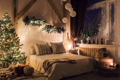 Warm and cozy evening in living room. Sofa bed In christmas Interior. concept the new year and holidays. Xmas in morning living room. Sofa bed In christmas royalty free stock image