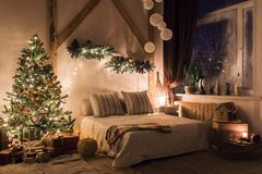 Warm and cozy evening in living room. Sofa bed In christmas Interior. concept the new year and holidays. Xmas in morning living room. Sofa bed In christmas royalty free stock photos