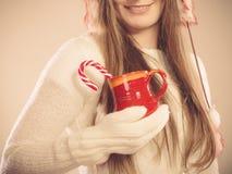 Xmas mug with cane. Royalty Free Stock Image