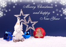 Xmas and new year card. Santa figure on blue background Royalty Free Stock Image