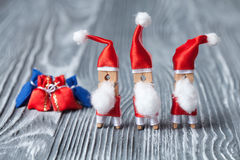 Xmas new year invitation card with Santas and bags of gifts. soft focus, vintage, gray wood background. Front view Stock Image
