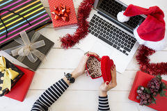Xmas online shopping with gift boxes Stock Photo