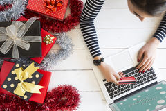 Xmas online shopping with gift boxes Stock Images