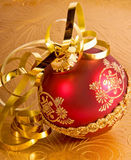Xmas ornament and gold ribbon Stock Images