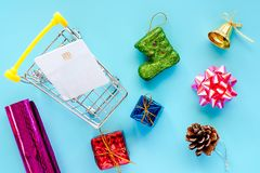Xmas ornaments with blank credit chip card and mini shopping car royalty free stock photos