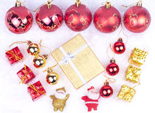 Xmas ornaments on snow Stock Images