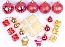 Xmas ornaments on snow. Xmas ornaments - santa figure, balls, gifts, stars Stock Images