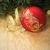 Xmas ornaments and spruce on crumpled paper backgr Stock Images