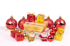 Xmas ornaments on white. Gold and red combination of xmas ornaments Stock Photos