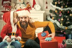 Xmas party celebration, fathers day. Winter holiday. New year small boy son and man. Christmas happy child and father with gift box, boxing day. Santa claus royalty free stock photos