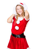 Xmas party girl listen to something Royalty Free Stock Images
