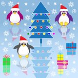 Xmas penguins Stock Images