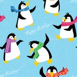 Xmas penguins in a bright scarfs dancing on ice floe seamless pa Stock Photos