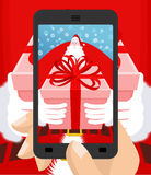 Xmas Photo Santa Claus to give gift. Christmas Photographing smartphone. Santas gloves and box with bow. Illustration for new yea vector illustration