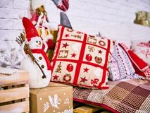 Xmas pillows with cover, Snowman and stars decor. New Year`s card scenery. Christmas concept. stock photos