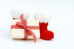 Xmas present and Christmas boots Royalty Free Stock Photography