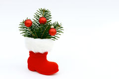 Xmas present and Christmas boots Royalty Free Stock Photos