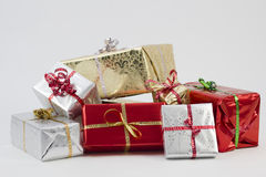 Xmas Presents. A studio Isolation of some cristmas presents wrapped up. The gifts have been shot with a shallow depth of field. They have ribbons with the words Royalty Free Stock Photos