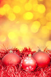 Xmas red balls on blurred yellow background Royalty Free Stock Photo
