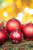 Xmas red balls and tree on yellow background Royalty Free Stock Photo