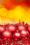 Xmas red bauble on blurred red yellow background Stock Image