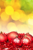 Xmas red bauble on blurred yellow green background Royalty Free Stock Images