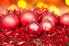 Xmas red baubles and tinsel on red background Stock Image
