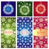 Xmas red, blue and green labels with paper snowflakes Royalty Free Stock Photography