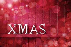 Xmas Red Christmas Background. A red Christmas background with the word Xmas on it Stock Image