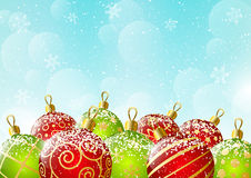 Xmas red and green balls on sky background. Xmas red and green balls on blue sky background Royalty Free Stock Image