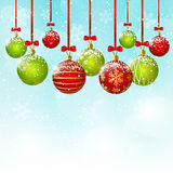 Xmas red and green balls on sky background Stock Photo
