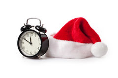 Xmas red hat and alarm clock Stock Photo