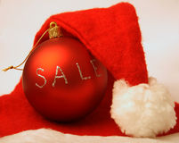 Xmas sale. Red ball and santa's hat Royalty Free Stock Images