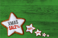 XMAS sale Cinnamon star on green wood concept Royalty Free Stock Images