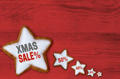 XMAS sale Cinnamon star on red wood concept Royalty Free Stock Photos