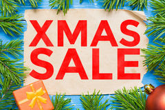 Xmas Sale concept. Christmas fir tree and vintage paper Royalty Free Stock Images