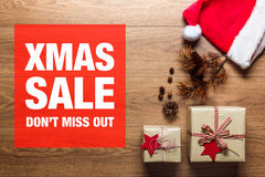 Xmas sale concept, desk with santa hat, view from above Stock Image