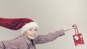 Happy shopping woman wearing Santa hat Royalty Free Stock Images