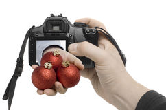 Xmas Shot. A hand reaches out of a digital camera Stock Image
