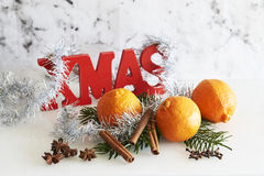 Xmas sign with tinsel, fir branch, clementines and Christmas ball Stock Images