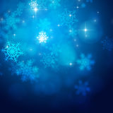 Xmas Snow Lights. Blue xmas background with snowflakes and blurry lights Stock Photos